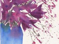 Purple lilies in a blue vase