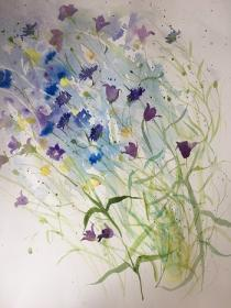 Blue cornflowers and companula flowers blowing over to the left with butterfly