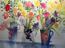Three collaged jugs containing daffs, tulips and hyacinths